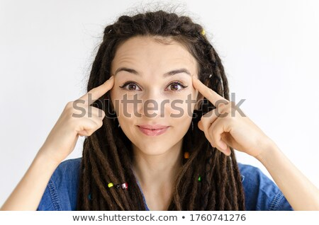 Concentrating businesswoman holding fingers on temples Stock photo © ichiosea