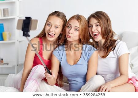 小さな · 女性 · 画像 · 携帯電話 · 笑みを浮かべて - ストックフォト © dolgachov