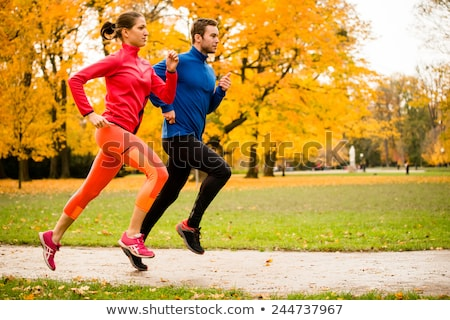 Man and woman running as fitness sport in an autumn park Stock photo © Kzenon
