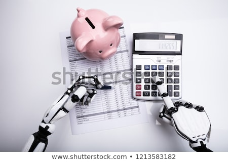 Robot Examining Financial Report With Calculator Stock photo © AndreyPopov