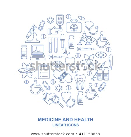 Medical Syringe Icon Isolated in Blue Background Stock photo © robuart
