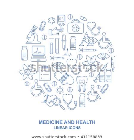 medical syringe icon isolated in blue background stock photo © robuart