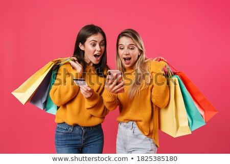 geschokt · twee · vrouwen · vrienden · mobiele · telefoon - stockfoto © deandrobot