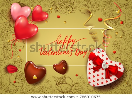 red heart shaped gift box with rose petals stock photo © inxti