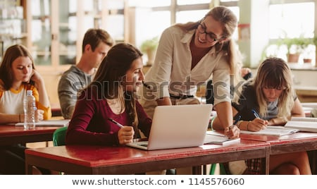 Stock fotó: Teacher Teaching Her Student On Computer