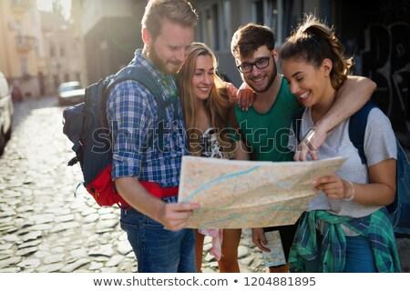 Boldog turisták városnézés város térkép építészet Stock fotó © Minervastock