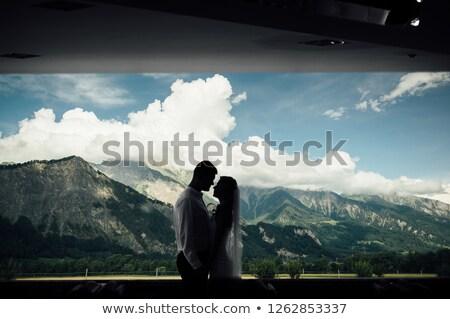Silhueta casal beijando montanhas Suíça janela Foto stock © ruslanshramko