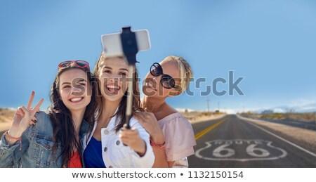 female friends taking selfie over us route 66 Stock photo © dolgachov