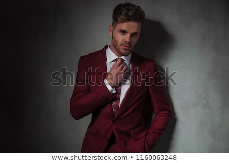 portrait of relaxed businessman fixing his hair stock photo © feedough