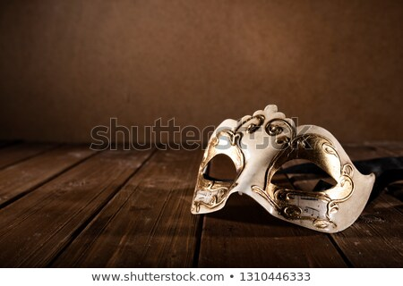 stll life of a carnival mask on a wood floor stock photo © alphaspirit