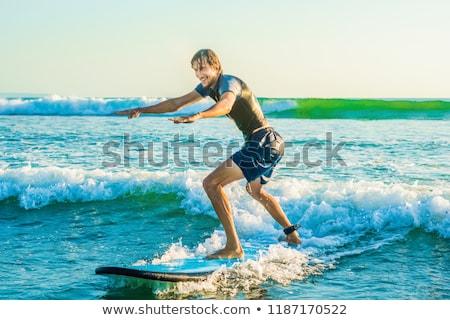 jonge · man · beginner · surfer · surfen · zee · schuim - stockfoto © galitskaya