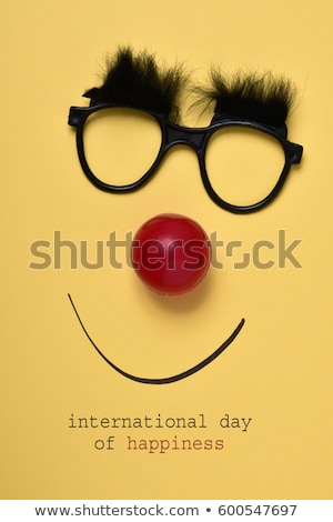 clown nose, smile and text happiness day Stock photo © nito
