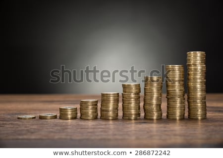 close up of increasing stacked coins stock photo © andreypopov