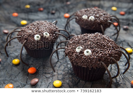 halloween party decorated cupcakes on wooden table stock photo © dolgachov