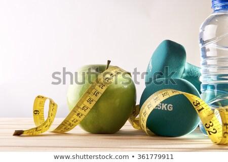 Fitness manubri nastro di misura bottiglia d'acqua legno top Foto d'archivio © karandaev
