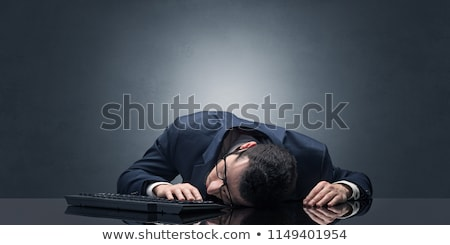Businessman fell asleep at the office on his keyboard Stock photo © ra2studio