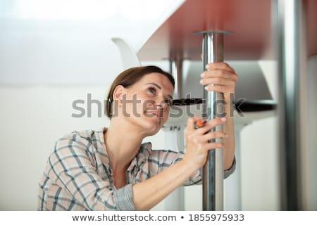 Female contractor repairing furniture at home  Stock foto © Elnur