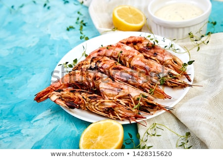Grilled big tiger shrimps prawns on white plate Stok fotoğraf © Illia