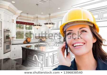 Female Contractor Using Cell Phone Over Kitchen Drawing Gradatin Stock photo © feverpitch
