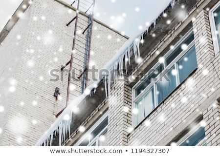 icicles on building or living house facade Stock photo © dolgachov