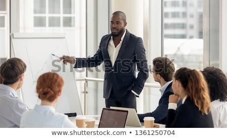 an african businessman giving presentation in office stock photo © andreypopov