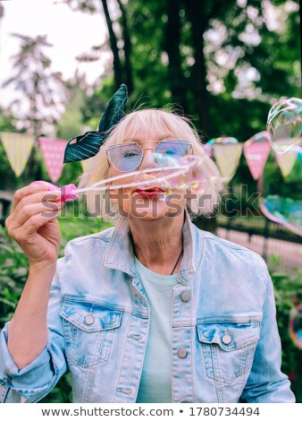 Happy Pensioners Senior People with Soap Bubbles Stock photo © robuart