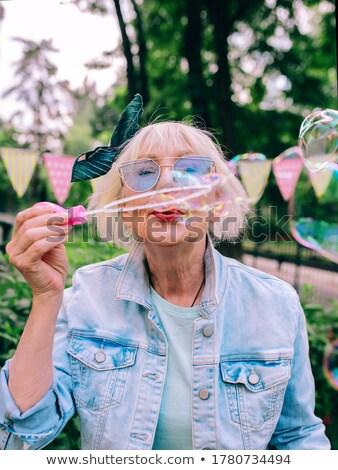 счастливым старший люди мыльные пузыри женщину Сток-фото © robuart