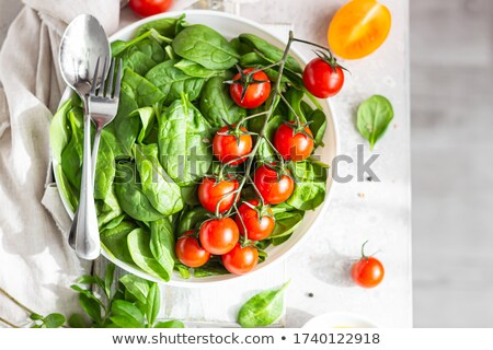 Fresh organic cherry tomatoes bunch on ceramic bowl. Stock photo © marylooo