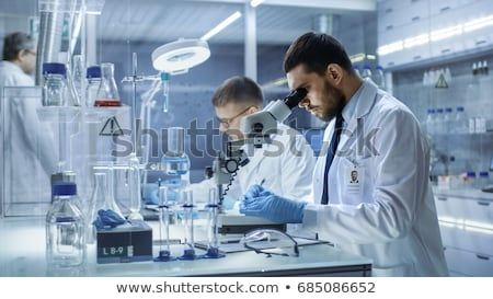 Stockfoto: Two Chemists Working In Lab Experimenting