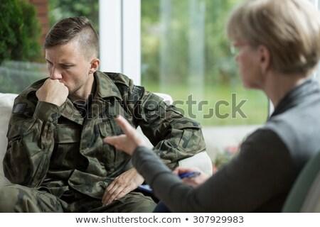 Médecin militaire fonctionnaire psychothérapie traitement Homme Photo stock © AndreyPopov