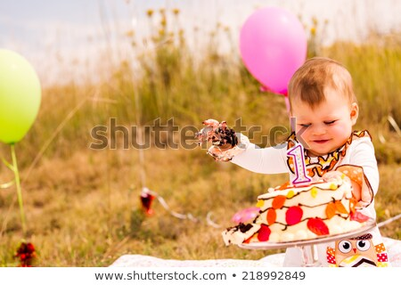 Baby girl celebrating her first bithday with gourmet cake Stock photo © Lopolo