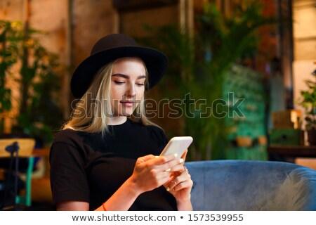 Szőke lány fehér farmer szoknya blúz Stock fotó © dashapetrenko