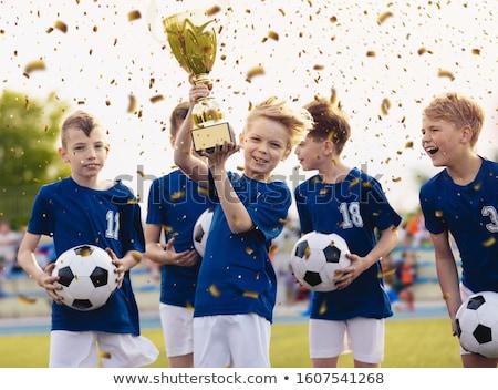 Foto stock: Feliz · crianças · escola · primária · equipe · de · esportes · futebol