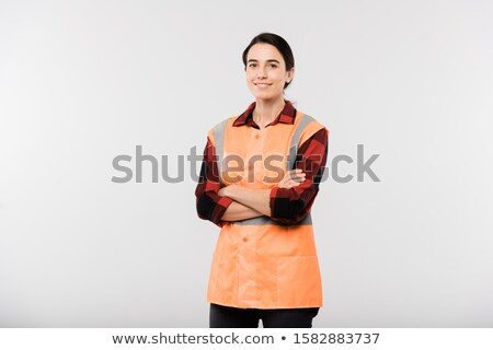 Happy young female engineer in workwear and orange jacket crossing arms by chest Stock photo © pressmaster