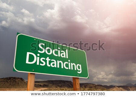 Social Distancing Green Road Sign Against Ominous Stormy Cloudy  Stock photo © feverpitch