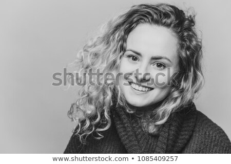 Satisfied happy woman with attractive look, pleasant smile and appealing appearance, dressed in blue Stock photo © vkstudio