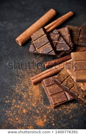 Csokoládé rácsok darabok halom fahéj por Stock fotó © marylooo