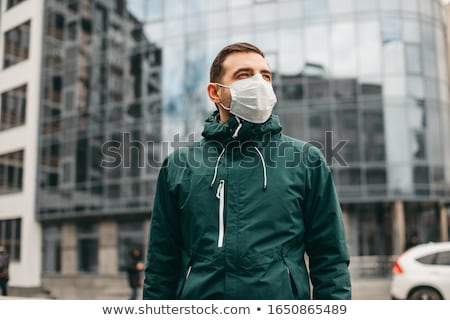 A man in the city with medical mask Stock photo © olira