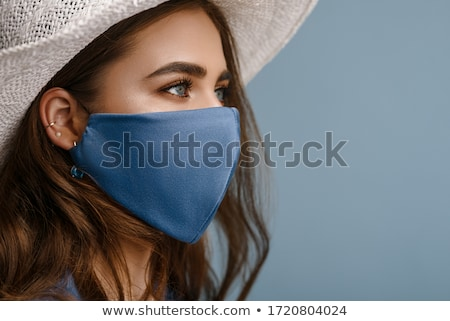 Confident attractive woman wearing a face mask Stock photo © Giulio_Fornasar