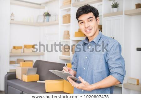 Asian business man startup SME entrepreneur or freelance working Stock photo © snowing