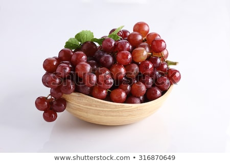 red grapes in a basket.  stock photo © inaquim