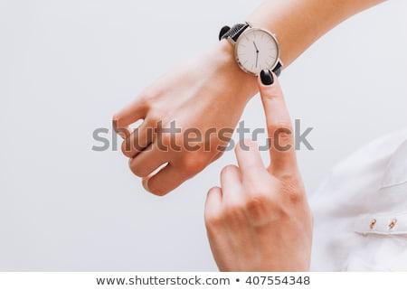 Nő idő karóra gyönyörű fiatal nő kéz Stock fotó © ilolab