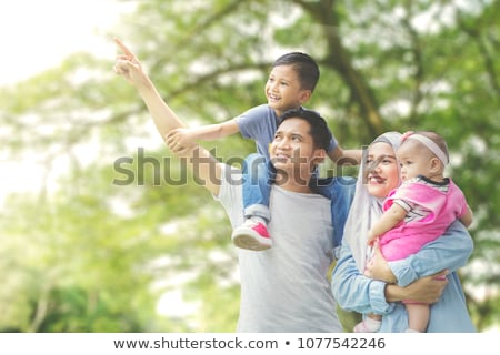 father,  son and mother look out for something Stock photo © Paha_L