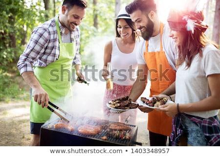 barátok · élvezi · barbecue · kert · csoport · fiatal - stock fotó © photography33