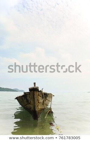 Roeiboot gebruikt zon zee achtergrond oceaan Stockfoto © smithore