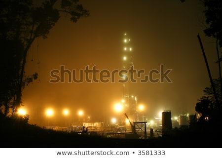 Fúrótorony köd megvilágított éjszaka olajkút tájkép Stock fotó © justinb