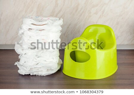 Stock photo: Toilet paper, diapers and blue potty