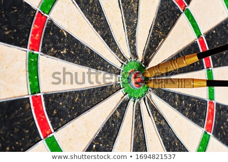 Several Darts Hit Bulls-Eye on Dart Board Competition Stock photo © iqoncept