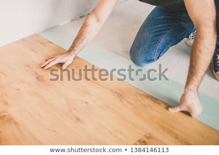 montage on man laying laminate flooring stock photo © photography33