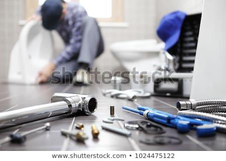 man fixing plumbing in bathroom stock photo © photography33